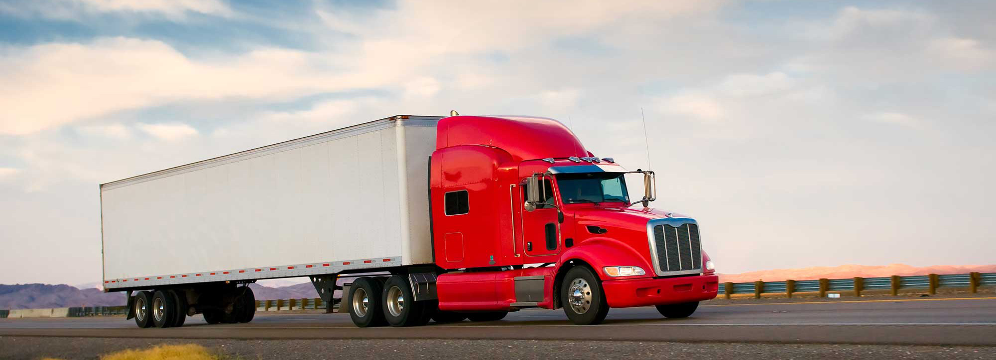 Stutsman-Logistics-Red-truck-dry-van-on-highway